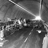 March 21, 1956 - Speeches and band music were the order of the day inside the old Waldo Tunnel yesterday, but outside, cannon boomed, jet fighters swooped and an Army M-47 tank roared around. It was all part of the ceremony opening the new tunnel, which doubles Marin approaches to the Golden Gate Bridge.