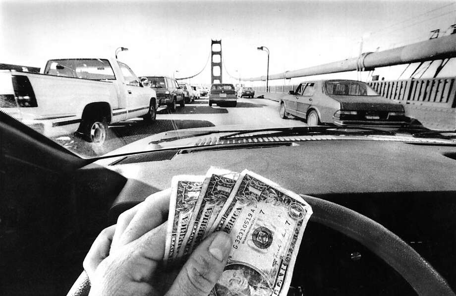 July 1, 1991 - $3 is needed to cross the Golden Gate Bridge now. Photo: Scott Sommerdorf, The Chronicle