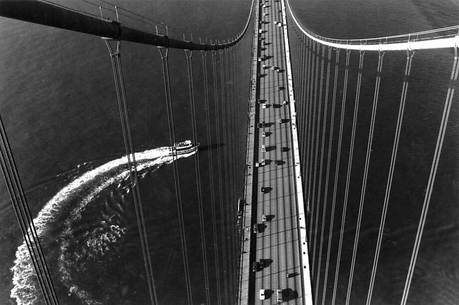 Feb 25, 1992 - The views were terrific as a tourboat did a U-turn just outside the Golden Gate Bridge. Both tourists and commuters alike were treated to spring-like weather even as the sun set in the west. Photo: Brant Ward, The Chronicle