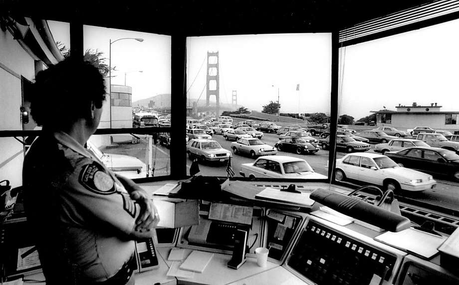 Jan 3, 1989 - Toll desk Sgt. Richard Ebert looks out at the traffic approaching the toll plaza. Photo: Michael Maloney, The Chronicle