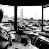 Jan 3, 1989 - Toll desk Sgt. Richard Ebert looks out at the traffic approaching the toll plaza.