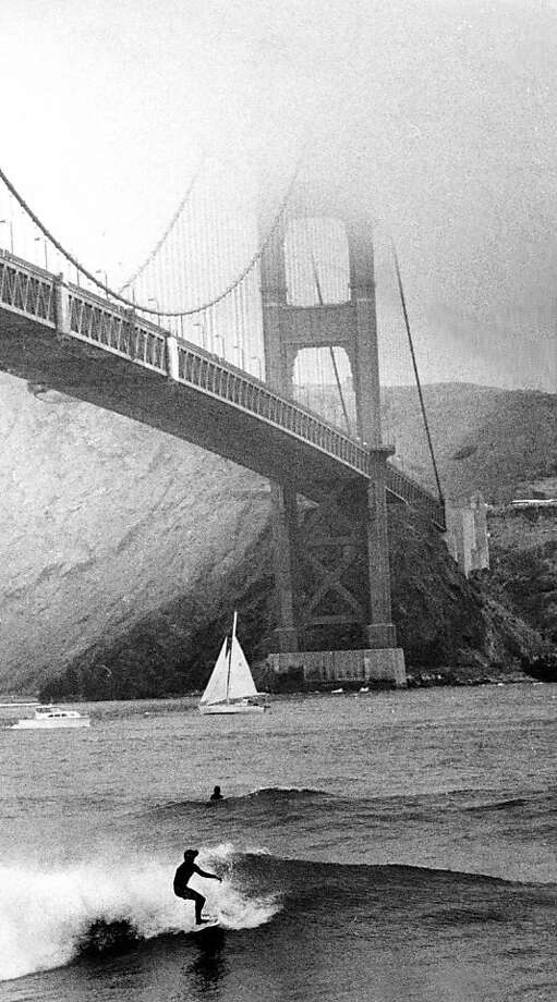 July 11, 1982 - Surfers enjoy high waves under the Golden Gate Bridge. Photo: Fred Larson, The Chronicle