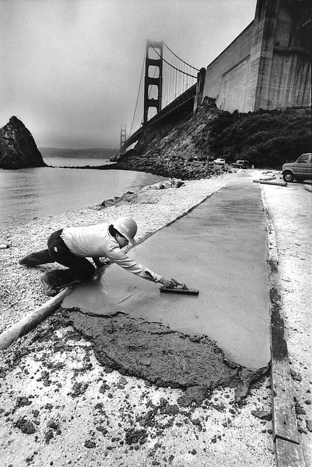 June 15, 1988 - Miguel Sanchez is pouring and smoothing out cement at the base of the Golden Gate Bridge (North Side). This is just the beginning of a new trail that will go from the bridge to Sausalito being built with Federal and local Parks funds. Photo: Steve Ringman, The Chronicle
