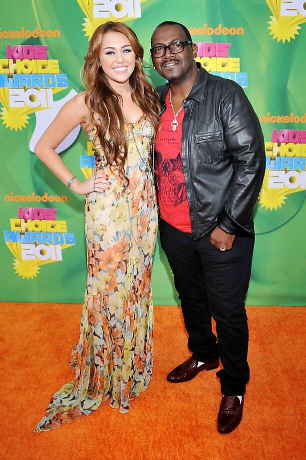 Miley Cyrus, left, and Randy Jackson arrive at Nickelodeon's 24th Annual Kids' Choice Awards on Saturday, April 2, 2011, in Los Angeles. Photo: Vince Bucci, AP