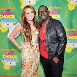 Miley Cyrus, left, and Randy Jackson arrive at Nickelodeon's 24th Annual Kids' Choice Awards on Saturday, April 2, 2011, in Los Angeles.