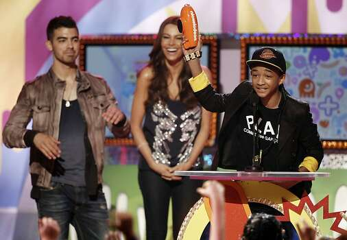 "Jaden Smith accepts the award for ""Favorite Movie"" as Joe Jonas, left, and Sofia Vergara, center, look on at Nickelodeon's 24th Annual Kids' Choice Awards on Saturday, April 2, 2011, in Los Angeles. Photo: Matt Sayles, AP"