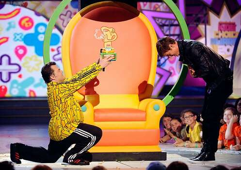 LOS ANGELES, CA - APRIL 02:  Actor Jack Black presents an award to Josh Duhamel onstage during Nickelodeon's 24th Annual Kids' Choice Awards at Galen Center on April 2, 2011 in Los Angeles, California. Photo: Kevork Djansezian, Getty Images
