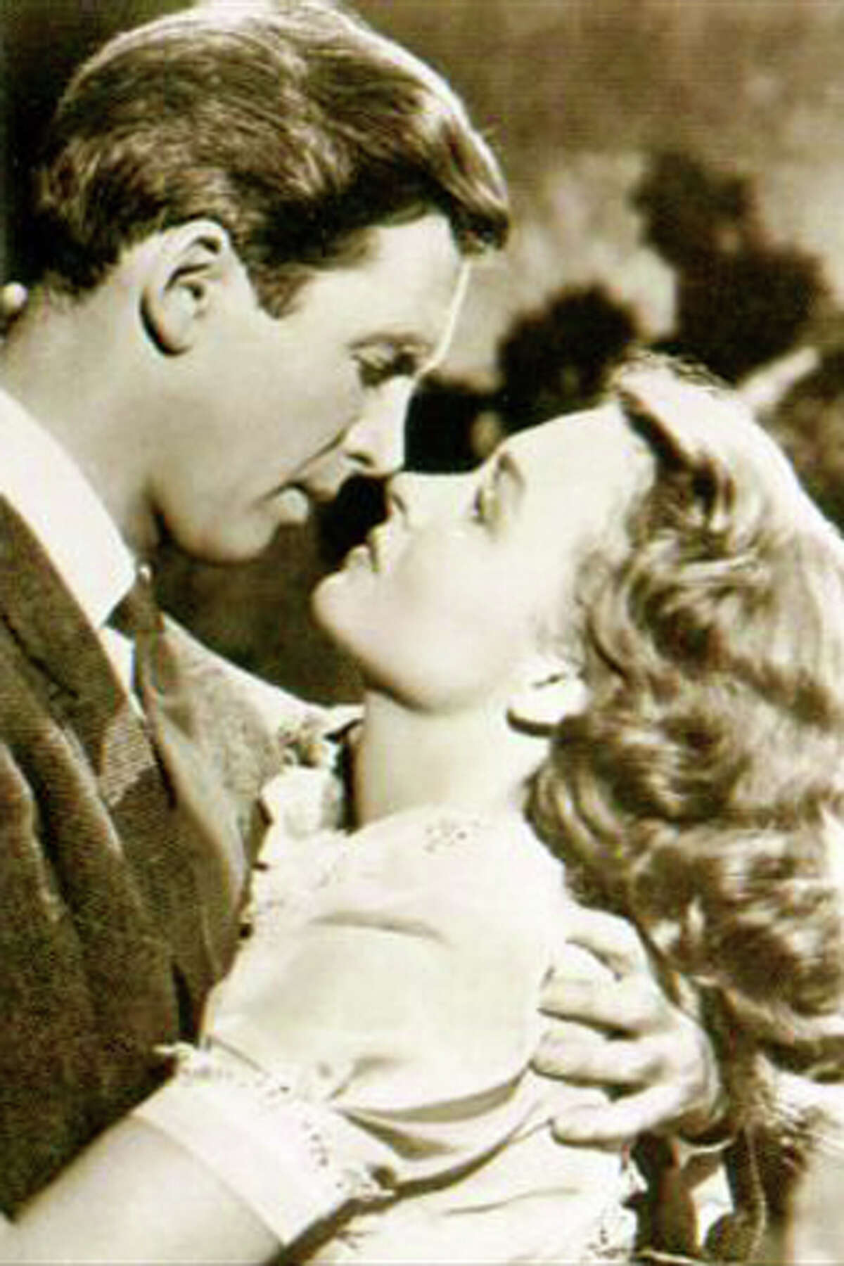 George and Mary about to kiss.