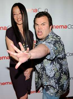 "LAS VEGAS, NV - MARCH 28:  Director Jennifer Yuh Nelson (L) and actor Jack Black joke around as they arrive to promote their upcoming film, ""Kung Fu Panda 2"" at The Colosseum at Caesars Palace during the opening night of CinemaCon, the official conventionof the National Association of Theatre Owners, March 28, 2011 in Las Vegas, Nevada. Photo: Ethan Miller, Getty Images"