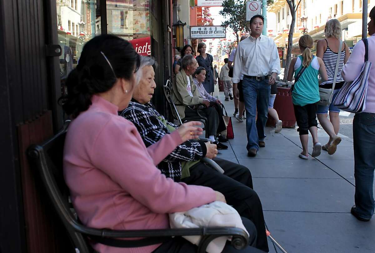 Vincent Pan, Executive Director of the Chinese for Affirmative Action, walks through chinatown, Monday June 20, 2011, in San Francisco,Calif.