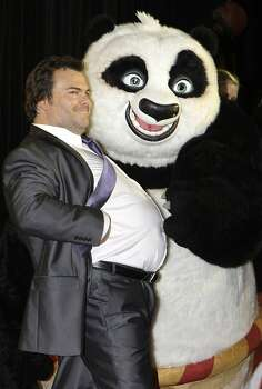 U.S. actor Jack Black poses with a panda character as he attends the Australian premiere of the movie Kung Fu Panda 2 in Sydney, Monday, June 13, 2011. Photo: Rick Rycroft, AP