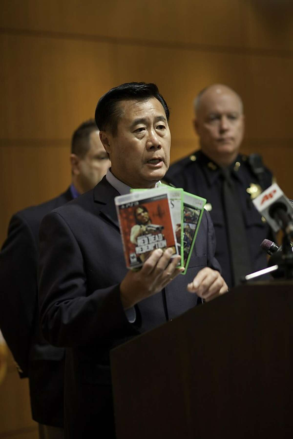 California State Senator Leland Yee speaks at a press conference on the Supreme Court Ruling of California's violent video game law at the Hiram Johnson State building in San Francisco, California, on Monday, June 27, 2011. Behind are Kevin Cashman, SFPD Deputy Chief (far right) and George Fouras, MD, American Academy of Child and Adolescent Psychiatry San Francisco Medical Society (left, partially hidden).