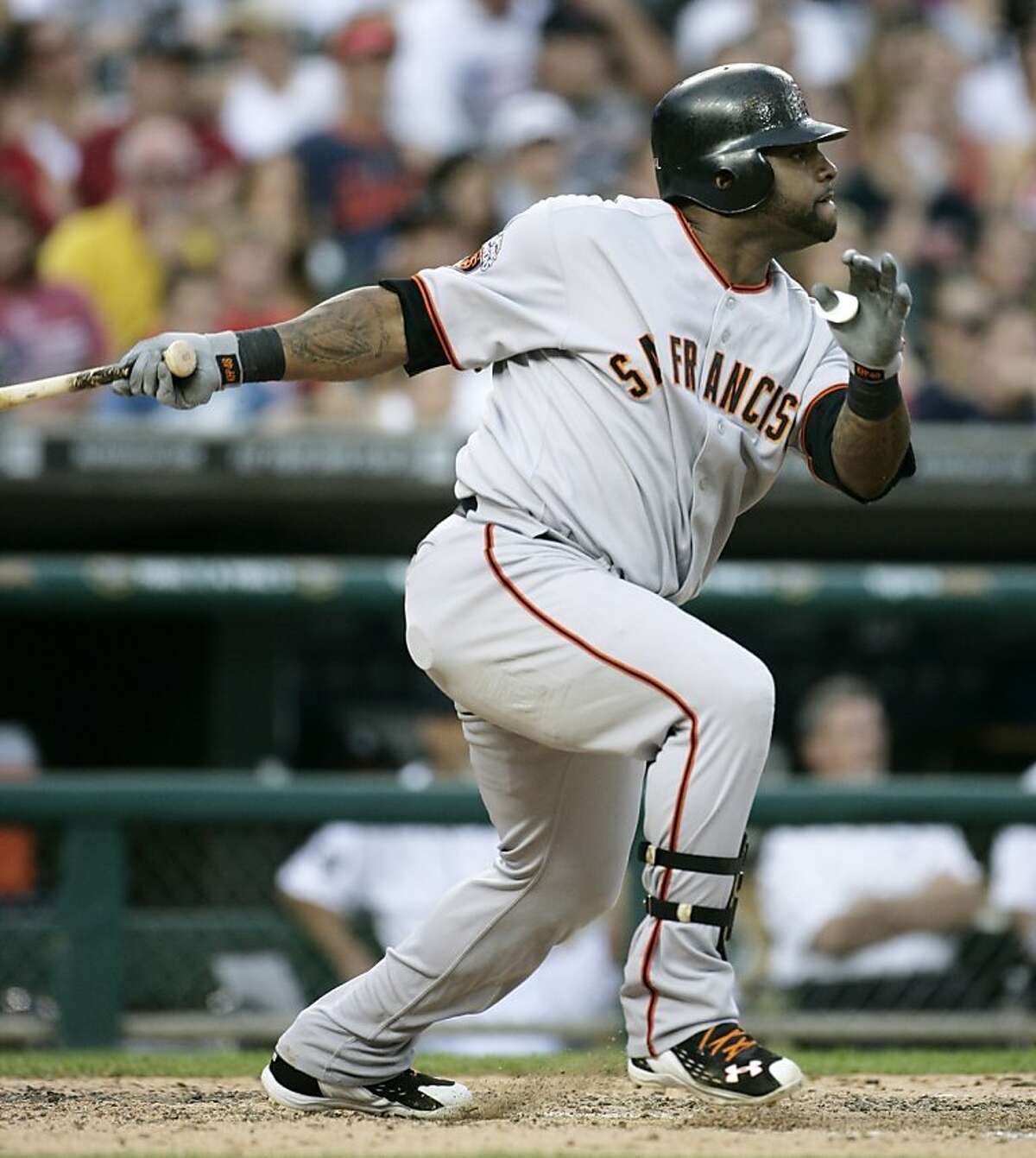 San Francisco Giants' Pablo Sandoval hits an RBI-double to drive in Aaron Roward from second base during the fifth inning of a interleague baseball game against the Detroit Tigers, Friday, July 1, 2011 in Detroit.
