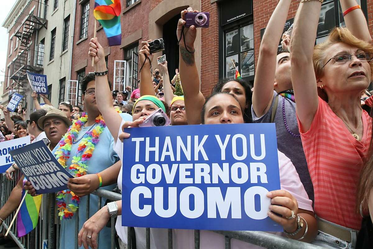 Spectators react as New York Gov. Andrew Cuomo and New York City Mayor Michael Bloomberg approach during the Gay Pride Parade Sunday June 26, 2011 in New York.
