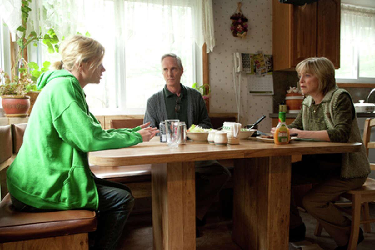 (L-R) Charlize Theron as Mavis Gary, Richard Bekins as David Gary and Jill Eikenberry as Hedda Gary in