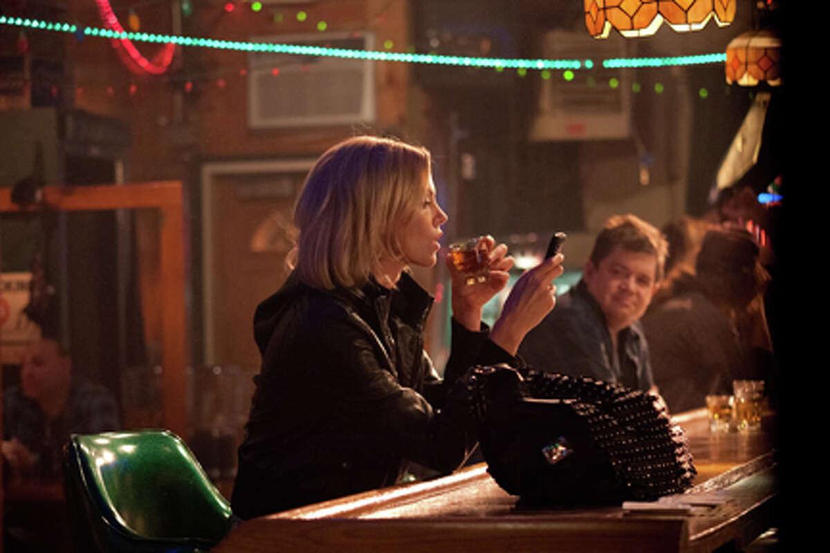Charlize Theron as Mavis Gary and Patton Oswalt as Matt Freehauf in