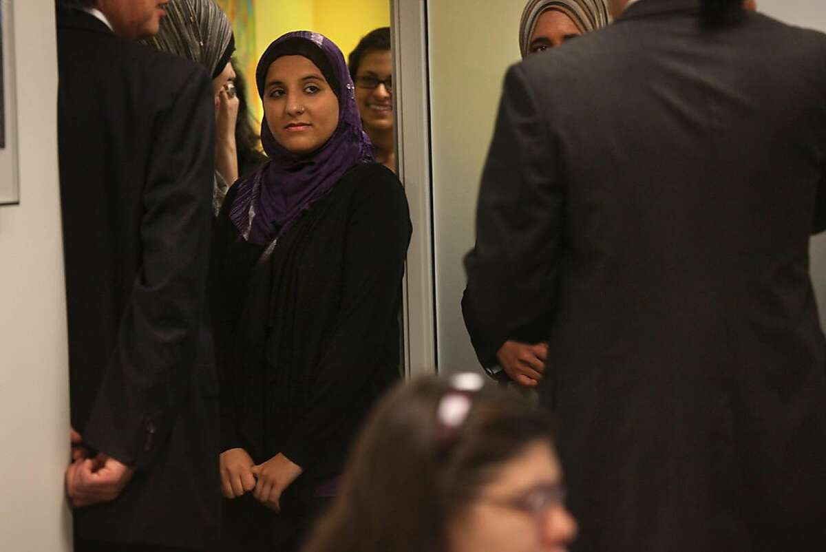 """Plaintiff Hani Khan from San Mateo filed a lawsuit today against Abercrombie and Fitch in San Francisco, Calif., on Monday, June 27, 2011. She was fired at a Hollister Co. store in the Hillsdale Mall location for refusing to remove her religious head scarf, or hijab. She was initially hired whe was told her hijab would not be in confilict with the company's """"look policy"""" so long as she wore it in company colors--red, white, and/or blue. She complied, but was then asked to remove her hijab while working four months later."""