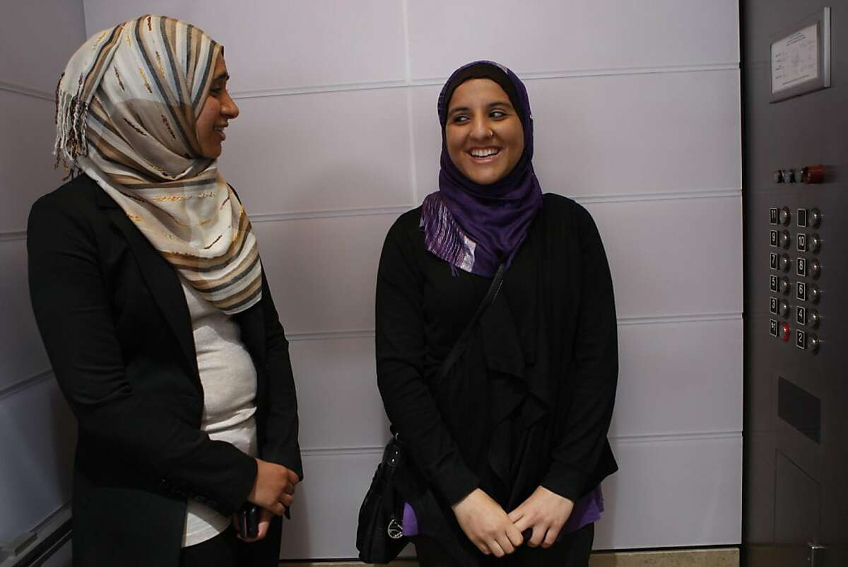 Zahra Billoo (left), executive director of the SF Bay Area office of the Council on American-Islamic Relations, with plaintiff Hani Khan (right) from San Mateo talk after a press conference in San Francisco, Calif., on Monday, June 27, 2011. Hani was fired at a Hollister Co. store in the Hillsdale Mall location for refusing to remove her religious head scarf, or hijab. She is filing a lawsuit today in the U.S. District Court for the Northern District of California against Abercrombie & Fitch.