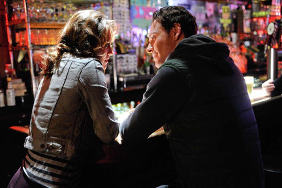 "Michael Fassbender (right) as Brandon in ""Shame."""
