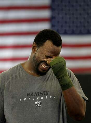 Marcel Reece, takes a break after a sparing exercise as the Oakland Raider fullback works out at Crispim Brazilian Jiu-Jutsu in Pleasanton, Ca. on Tuesday June 14, 2011. Reece keeps in shape during the NFL off season with daily workouts at the center. Photo: Michael Macor, The Chronicle