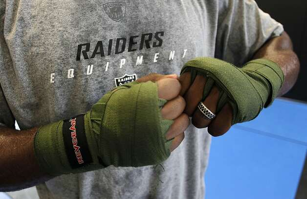 Marcel Reece wraps his hands as he prepares for a boxing exercise, as the Oakland Raider fullback works out at Crispim Brazilian Jiu-Jutsu in Pleasanton, Ca. on Tuesday June 14, 2011. Reece keeps in shape during the NFL off season with daily workouts at the center. Photo: Michael Macor, The Chronicle
