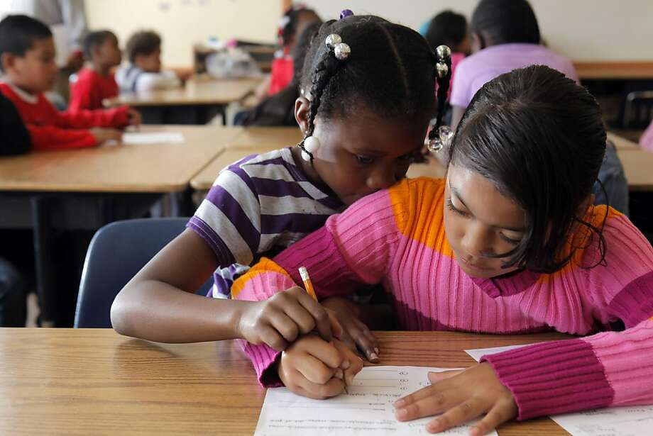 Keiara Franklin, left, helps her classmate, Nellie Gaoteote with a school assignment during a summer school program at John Muir Elementary School in San Francisco, Calif., on Wednesday, June 29, 2011. Photo: Carlos Avila Gonzalez, The Chronicle