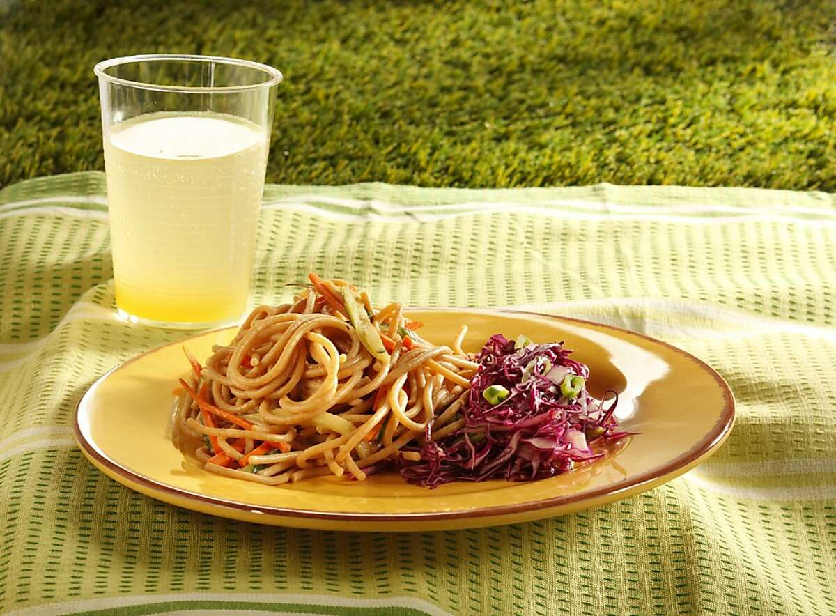 Cold-sesame peanut noodles, red cabbage & sugar snap pea slaw, and a mango ginger sparkler, as seen Wednesday, California, on Wednesday, June 22, 2011. Food styled by Amanda Gold and Erick Wong.