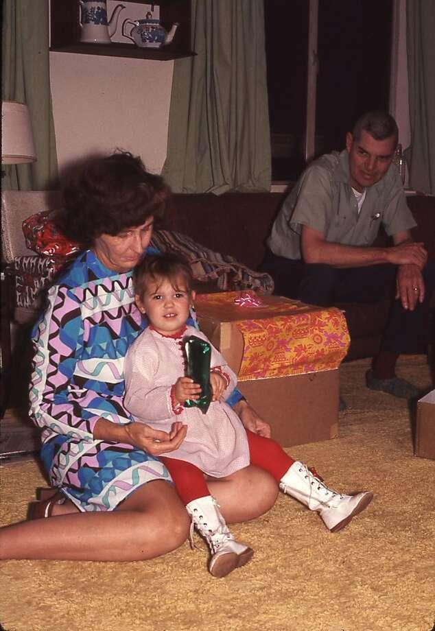 Writer Meredith May, age 2, opening presents with Grandma May in Pacific Grove, and Grandpa May (right). Photo: David May