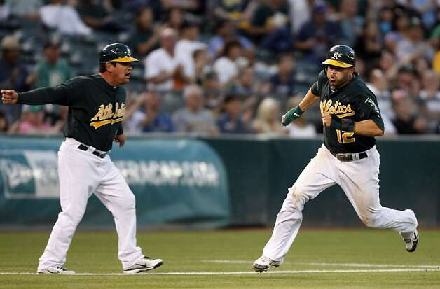 Oakland Athletics David DeJesus rounds third base in front of A's third base coach Mike Gallego as he scores in the 5th inning against the Arizona Diamondbacks Friday July 1, 2011. Photo: Lance Iversen, The Chronicle