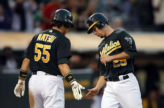 Oakland Athletics Hideki Matsui greets  Scott Sizemore at home plate after Sizemore scored in the 5th inning against the Arizona Diamondbacks Friday July 1, 2011. Photo: Lance Iversen, The Chronicle