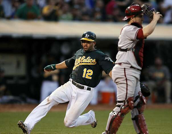 Oakland Athletics David DeJesus scores in the 5th inning against the Arizona Diamondbacks Friday July 1, 2011. Photo: Lance Iversen, The Chronicle