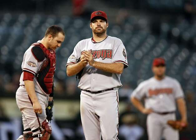 Arizona Diamondbacks starting pitcher Josh Collmenter waits for his pitching coach to arrive at the mound after giving up four runs to the Oakland Athletics in the 5th inning Friday July 1, 2011. Photo: Lance Iversen, The Chronicle