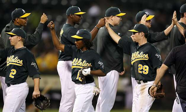 The Oakland Athletics celebrate their 5-4 win over the Arizona Diamondbacks Friday July 1, 2011. Photo: Lance Iversen, The Chronicle