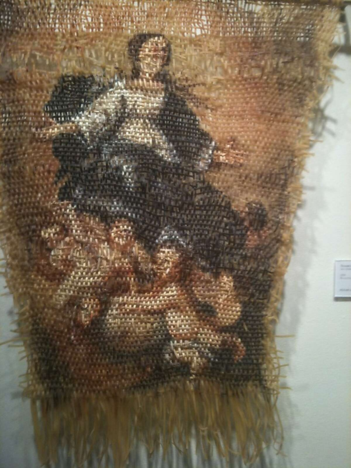 This tapestry by Lisa Venditelli, of woven fettucine and acrylic paint, illustrates the ascension into heaven of the Virgin Mary, accompanied by angels.