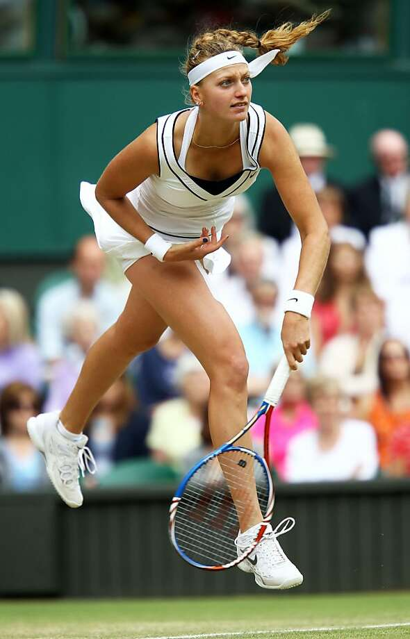 LONDON, ENGLAND - JUNE 30:  Petra Kvitova of the Czech Republics in action during her Women's semifinal match against  Victoria Azarenka of Belarus on Day Ten of the Wimbledon Lawn Tennis Championships at the All England Lawn Tennis and Croquet Club on June 30, 2011 in London, England. Photo: Julian Finney, Getty Images