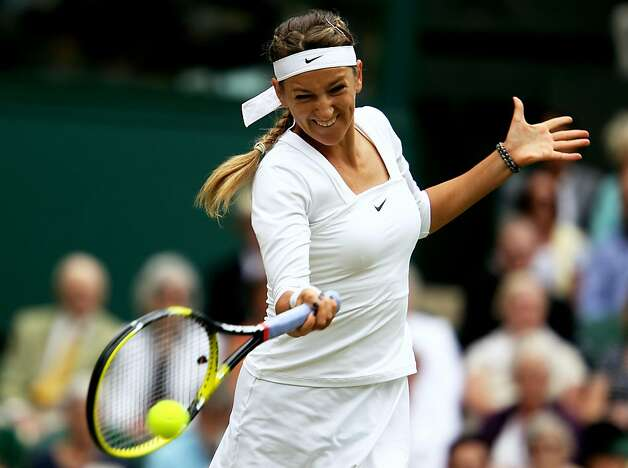 Victoria Azarenka of Belarus hits a forehand during the Women's semi final match against Petra Kvitova of the Czech Republic on Day Ten of the Wimbledon Lawn Tennis Championships at the All England Lawn Tennis and Croquet Clubon June 30, 2011 in London, England. Photo: Julian Finney, Getty Images