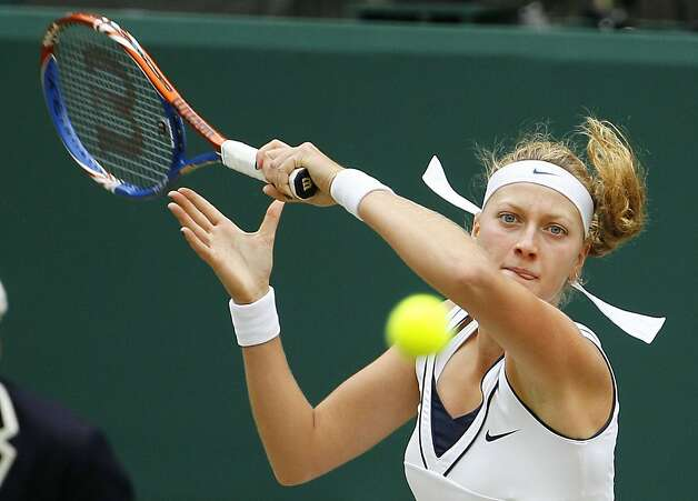 Petra Kvitova of the Czech Republic returns a shot to Victoria Azarenka of Belarus during their semifinal match at the All England Lawn Tennis Championships at Wimbledon, Thursday, June 30, 2011. Photo: Kirsty Wigglesworth, AP