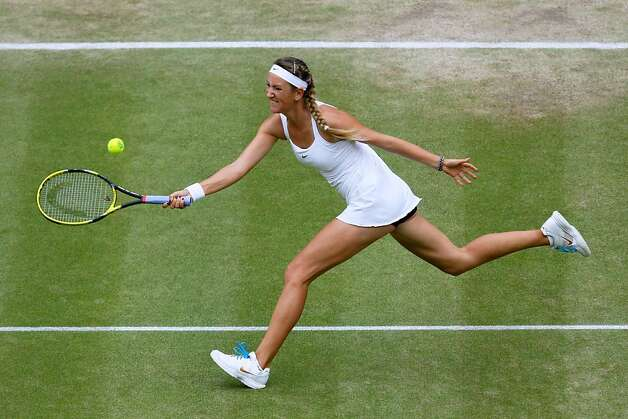 Victoria Azarenka of Belarus reaches for a shot during her Women's semifinal match against Petra Kvitova of the Czech Republic on Day Ten of the Wimbledon Lawn Tennis Championships at the All England Lawn Tennis and Croquet Club on June 30, 2011 in London, England. Photo: Pool, Getty Images