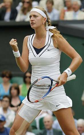 Petra Kvitova of the Czech Republic celebrates a point win during the semifinal match agaiunst Victoria Azarenka of Belarus at the All England Lawn Tennis Championships at Wimbledon, Thursday, June 30, 2011. Photo: Anja Niedringhaus, AP