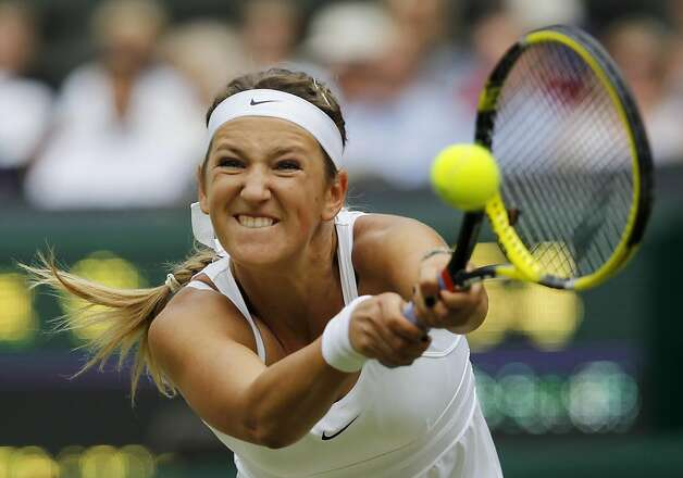 Victoria Azarenka of Belarus returns a shot to Petra Kvitova of the Czech Republic during their semifinal match at the All England Lawn Tennis Championships at Wimbledon, Thursday, June 30, 2011. Photo: Anja Niedringhaus, AP
