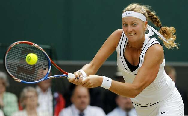 Petra Kvitova of the Czech Republic returns a shot to Victoria Azarenka of Belarus during their semifinal match at the All England Lawn Tennis Championships at Wimbledon, Thursday, June 30, 2011. Photo: Anja Niedringhaus, AP