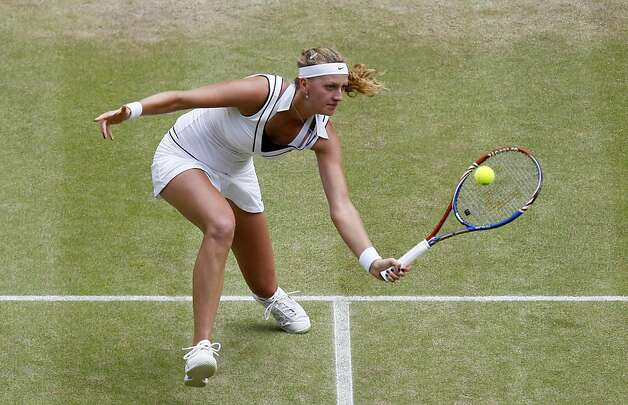 Petra Kvitova of the Czech Republic returns a shot to Victoria Azarenka of Belarus during their semifinal match at the All England Lawn Tennis Championships at Wimbledon, Thursday, June 30, 2011. Photo: Alastair Grant, AP
