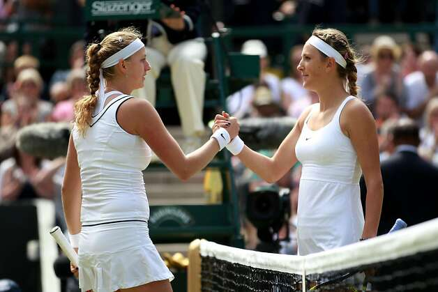 Petra Kvitova of the Czech Republic (L) shakes hands with Victoria Azarenka of Belarus after winning her Women's semifinal match on Day Ten of the Wimbledon Lawn Tennis Championships at the All England Lawn Tennis and Croquet Club on June 30, 2011 in London, England. Photo: Julian Finney, Getty Images