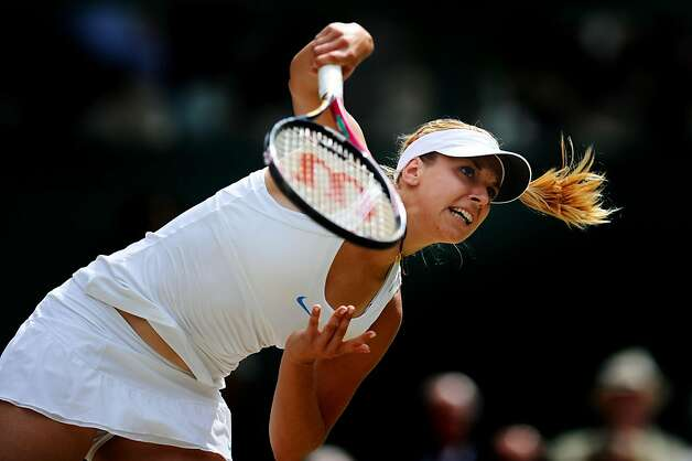 Sabine Lisicki of Germany serves during her semifinal round match against Maria Sharapova of Russia on Day Ten of the Wimbledon Lawn Tennis Championships at the All England Lawn Tennis and Croquet Club on June 30, 2011 in London, England. Photo: Clive Mason, Getty Images
