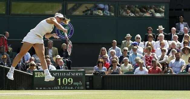 Germany's Sabine Lisicki serves to Russia's Maria Sharapova during their semifinal match at the All England Lawn Tennis Championships at Wimbledon, Thursday, June 30, 2011. Photo: Anja Niedringhaus, AP