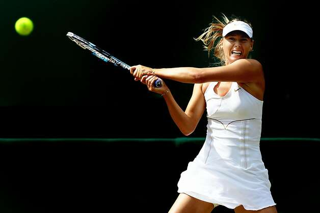 Maria Sharapova of Russia returns a shot during her semifinal round match against  Sabine Lisicki of Germany on Day Ten of the Wimbledon Lawn Tennis Championships at the All England Lawn Tennis and Croquet Club on June 30, 2011in London, England. Photo: Clive Brunskill, Getty Images