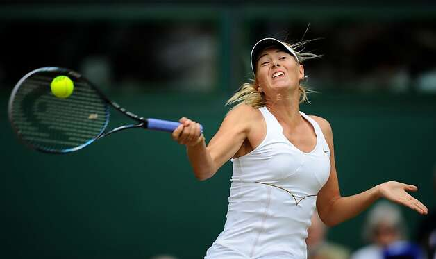 Maria Sharapova of Russia returns a shot during her semifinal round match against  Sabine Lisicki of Germany on Day Ten of the Wimbledon Lawn Tennis Championships at the All England Lawn Tennis and Croquet Club on June 30, 2011in London, England. Photo: Clive Mason, Getty Images
