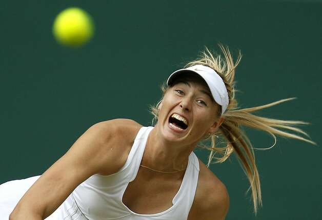 Russia's Maria Sharapova serves to Germany's Sabine Lisicki during their semifinal match at the All England Lawn Tennis Championships at Wimbledon, Thursday, June 30, 2011. Photo: Alastair Grant, AP