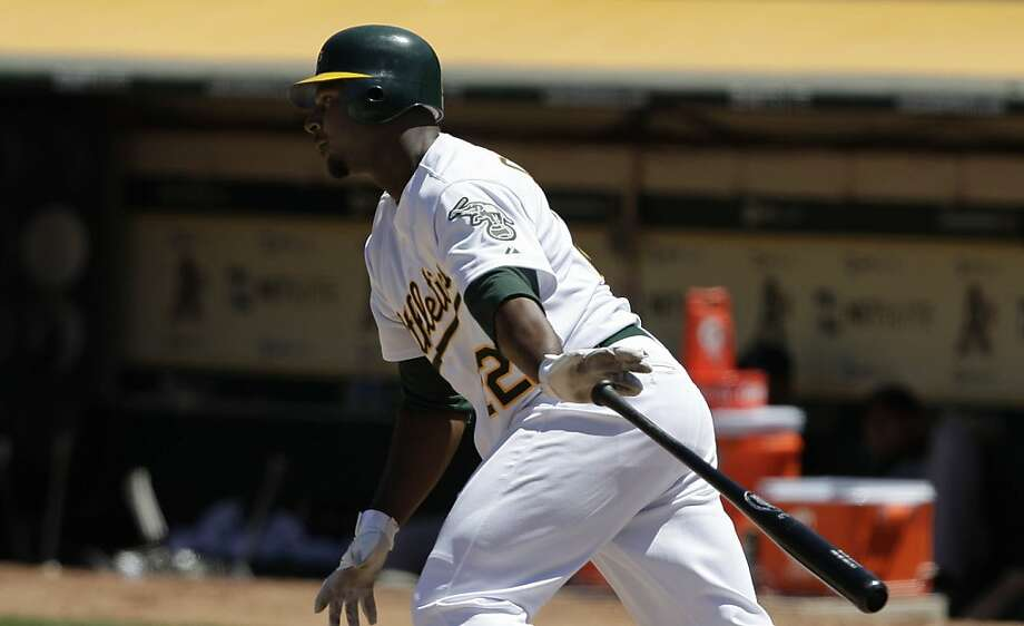 The Athletics Chris Carter releases his bat after hitting the ball during the the Oakland Athletcis vs. Florida Marlins game in Oakland, Calif. Final score: Marlins: 5 - Oakland: 4. Photo: Lea Suzuki, The Chronicle