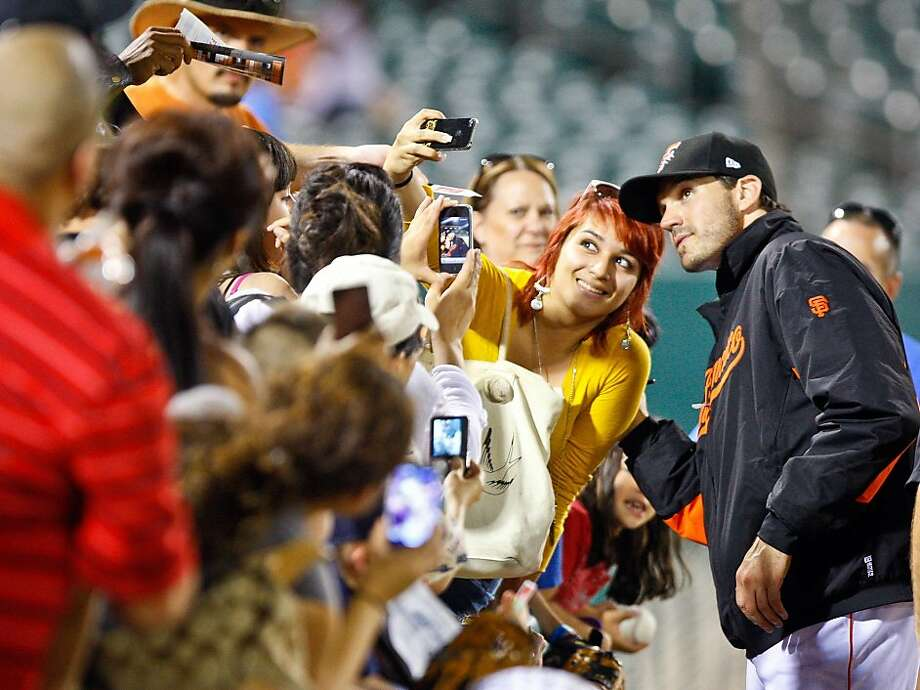 CRAIG KOHLRUSS/THE FRESNO BEE San Francisco Giants pitcher Barry Zito has his photo taken with a fan as many Fresno well-wishers come down to celebrate his 2-hitter complete game with the Fresno Grizzlies against Salt Lake at Chukchansi Park Tuesday, June 21, 2011. Photo: Craig Kohlruss